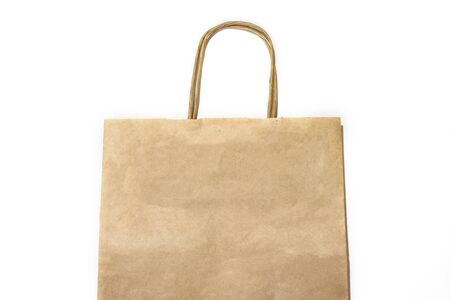 Top view paper craft shopping bag isolated on the white background. Zero waste concept. Say no plastic. Space for text. Flat lay.