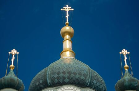 orthodox christian cross on against the sky photo