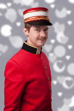 Portrait of a concierge  porter  in a red jacket photo