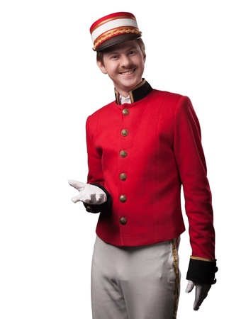 Portrait of a concierge  porter  in a red jacket on a white background  Isolated on white Stock Photo