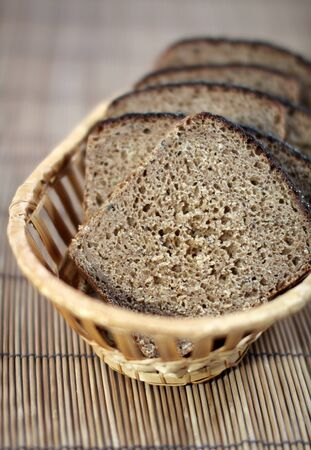 degradation: The cut rye bread on a straw support it is large with degradation of a background Stock Photo