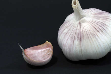 largely: Garlic largely, a segment and the whole head on