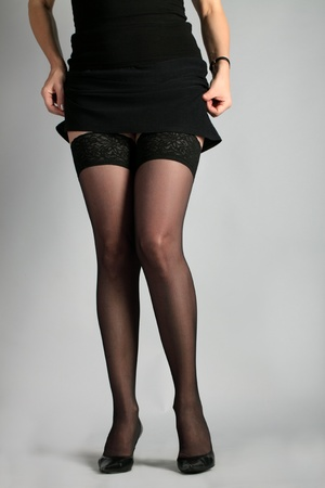 Sexual legs of the woman in stockings and black shoes. photo