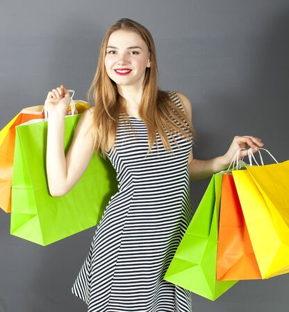 Young smiling girl with package for shopping