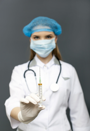 Doctor, nurse in mask With Injection syringe
