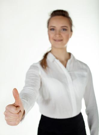 Slender bussiness woman holds hand extended forward. White background