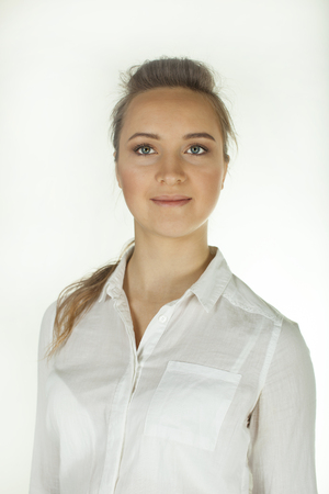 Young woman in white blouse. Portrait .White background