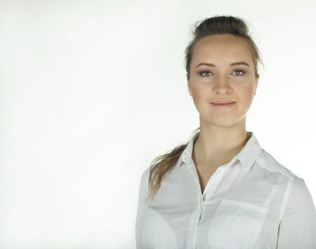 Young woman in white blouse. Portrait .White background with place for text