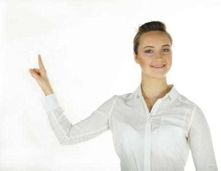 Smiling business woman holds finger up.Portrait.White background Standard-Bild