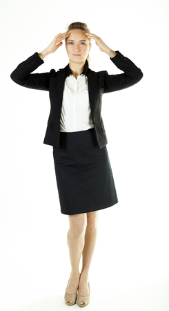 Smiling business woman in office clothes holds hands at head. White background