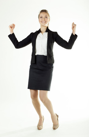 Smiling business woman shows emotion of joy. White background