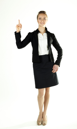 Young business woman draws attention, shows finger up and smile
