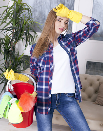 Tired woman housewife with bucket