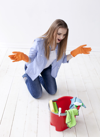 Woman housewife surprises with emotion. Cleaning team
