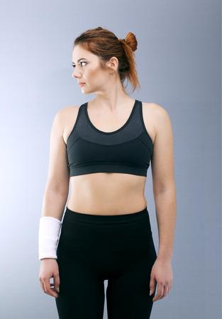 Sport serios girl looks sideways. Portrait Standard-Bild
