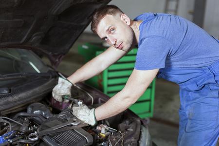 Mechanic repair car in car repair shop