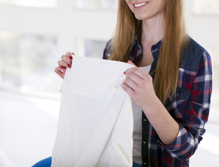 Happy young woman with towel in hands smile.Cropped image
