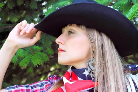 one girl on the nature dressed in western style photo