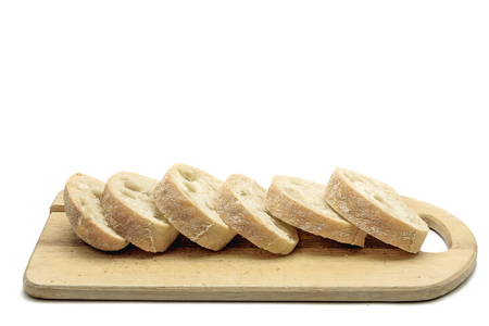 ciabatta: cut ciabatta lies on carving board isolated on white background Stock Photo