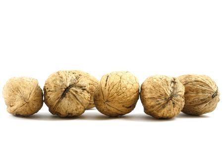 nourishing: healthy tasty nourishing walnuts isolated on white background