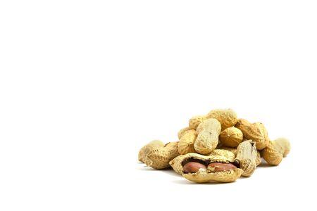 nourishing: healthy tasty nourishing peanuts isolated on white background