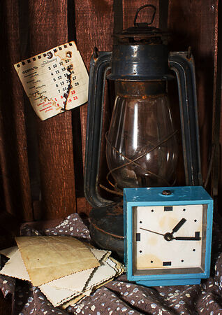 primus: Old rusty kerosene stove and an alarm clock in vintage style