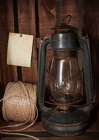 Old kerosene stove and a roll of twine on a rustic in vintage style