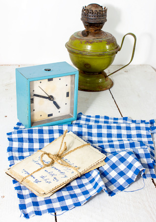 Old photographs, alarm clock and kerosene stove in a rustic style