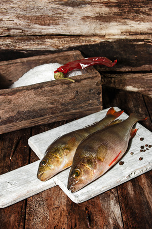 silver perch: Fresh fish on the kitchen before cutting
