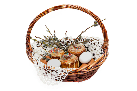 willows: Festive easters cakes and willows twigs in a basket on a white background Stock Photo