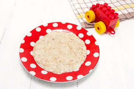 nourishing: Nourishing useful porridge for breakfast. Baby food Stock Photo