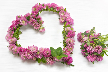 Beautiful wreath of red clover as a sign of love and affection