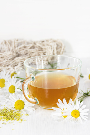 chamomile tea: Chamomile tea in a transparent cup on the table Stock Photo