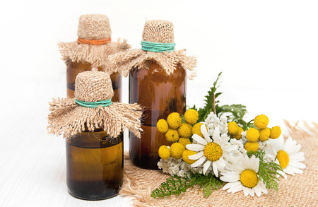 brown bottles: infusion of herbs in brown bottles Stock Photo