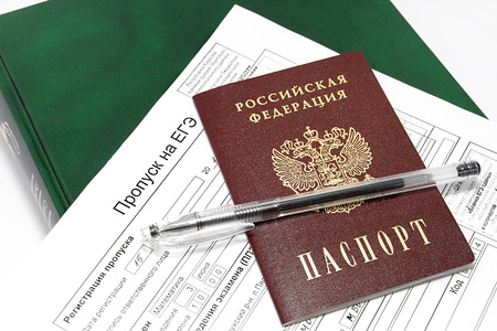 appointed: Skipping to the exam, a passport and a pen on the thick green book. Russia