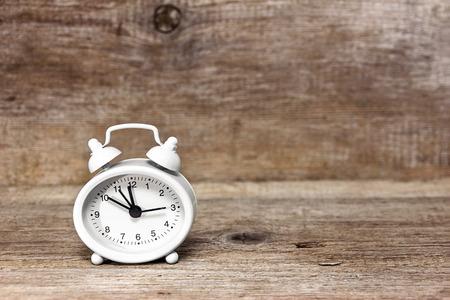 midnight: White alarm clock showing midnight