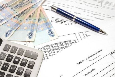 It blank the form used of time  and payroll  Russian employeepayment, bill, number, paper, spent hours on the days of the month Stock Photo