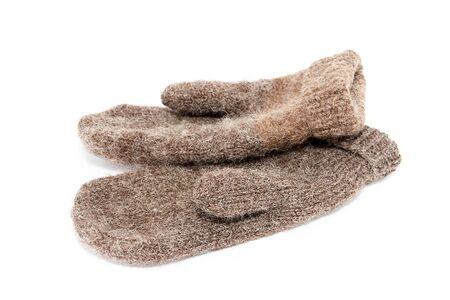 Warm winter mittens on a white background