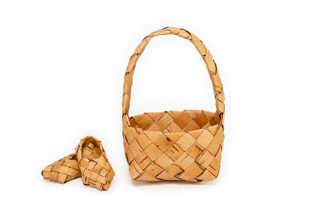wicker work: Products made of birch bark on a white background Stock Photo