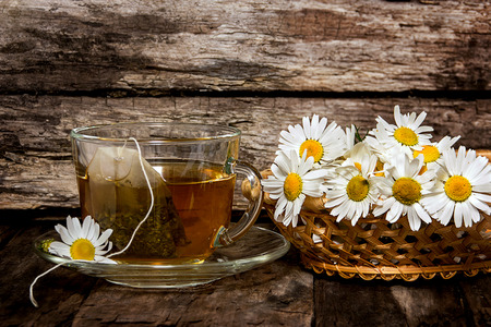 infusion: Chamomile tea. Medicinal infusion in a transparent Cup and camomile