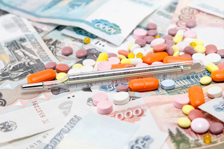 paid medicine: Tablets, a thermometer, and a lot of money. paid medicine