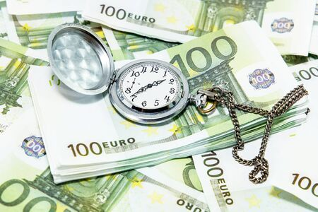 The clock on the background of the euro Money in the photo is the souvenirs are not a means of payment