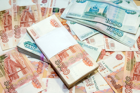 Time to pay taxes. Bundles of money in the cash register Фото со стока