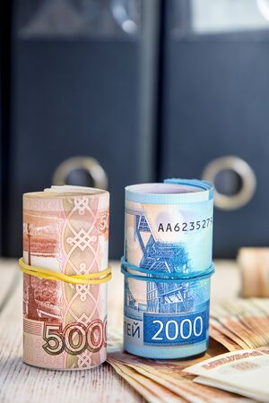 It's time to pay taxes. A lot of Russian money. Five thousand and two thousand rubles notes