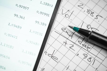 Data analyzing in forex market: the charts and quotes on smartphone display.
