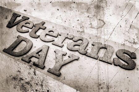 corroded: Veterans day banner. Veterans Day inscription stylized background as old bw sepia toned photos. Stock Photo