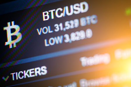 Data analyzing in exchange stock market: the charts and quotes on display. Analytics pair BTC-USD (Bitcoin  US Dollar), the most popular bitcoin pair in the world. Stock Photo