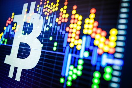 Data analyzing in exchange stock market: the candle chars on display. Analytics price change cryptocurrency BTC to USD (Bitcoin  US Dollar), the most popular pair in the world. Stock Photo