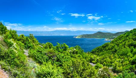 Wonderful romantic summer afternoon landscape panorama coastline Adriatic sea. The magical clear transparent azure water in the bay. Krk island. Croatia. Europe.