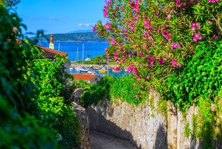 Wonderful romantic summer afternoon landscape coastline Adriatic sea. Narrow streets paved with stone. Krk island. Croatia. Europe. Imagens